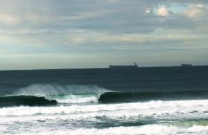 Redhead Beach surfer 25-7-11