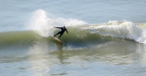 John Purnell surfing Paulownia board